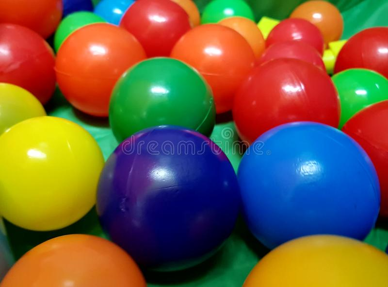 Game balls of various colors for children and babies stock image