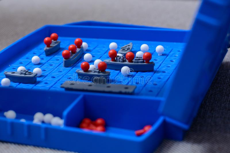Game-battleship closeup. Toy warships and submarine are placed on the playing field. concept-strategy, thinking, victory, defeat.  stock photo