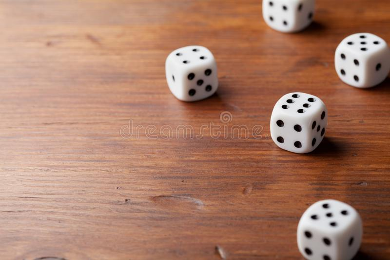 Game of chance concept. White dice on rustic wooden board. royalty free stock photo