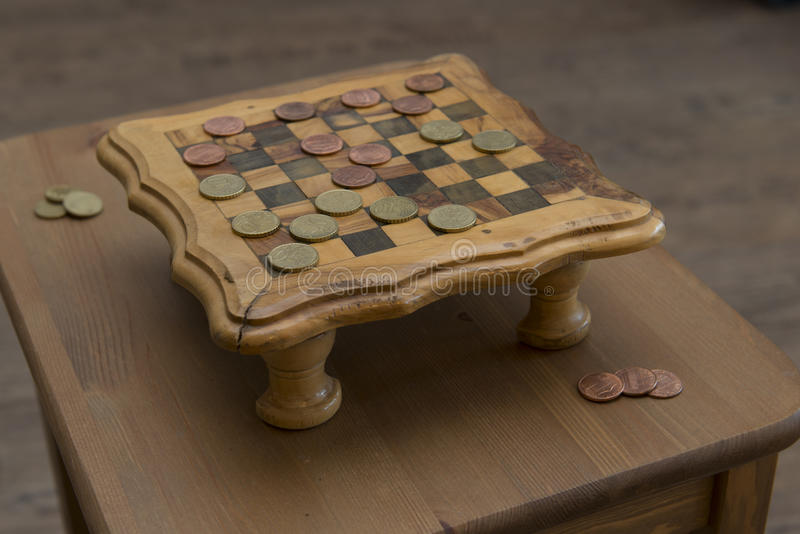 Game of checkers - US cents VS eurocents. Game of checkers - US cents VS euro cents royalty free stock photography