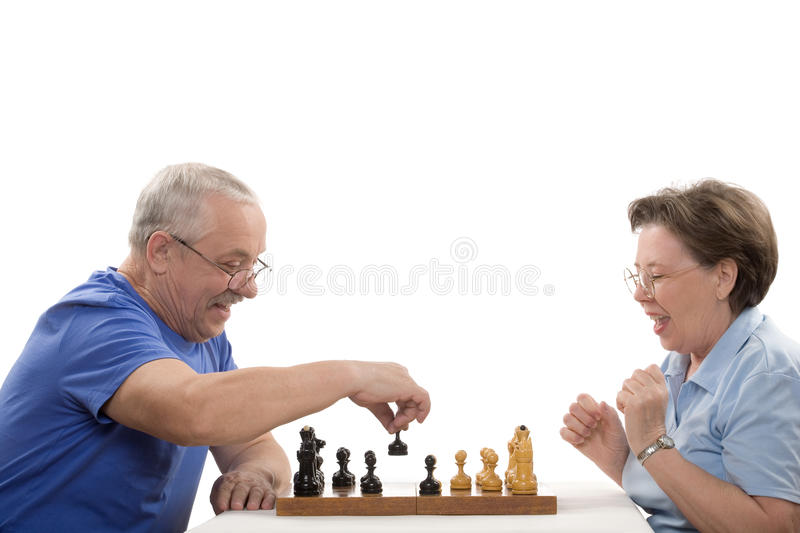 Game in chess. The elderly pair playing chess on white background stock image
