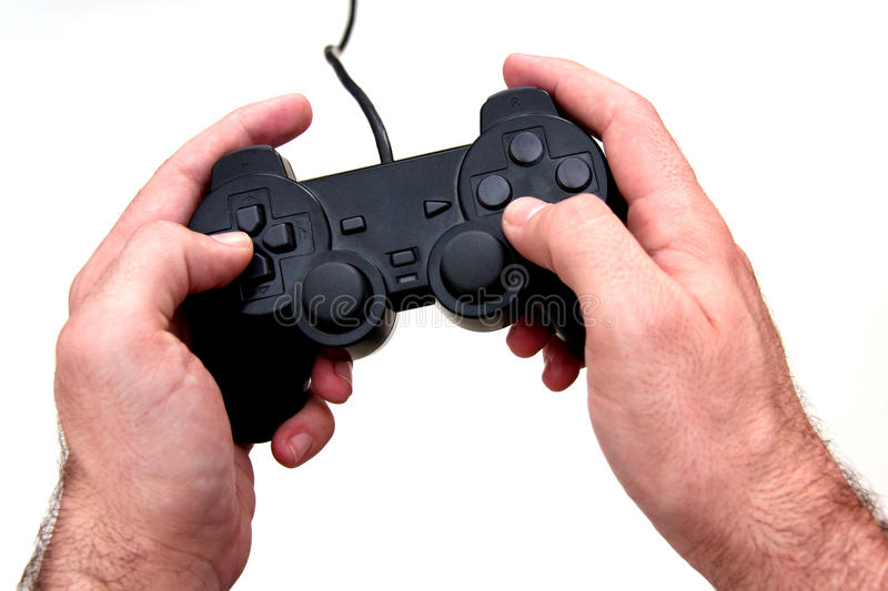 Game console gamepad. Photo of a wired video game console gamepad being hold/used stock image
