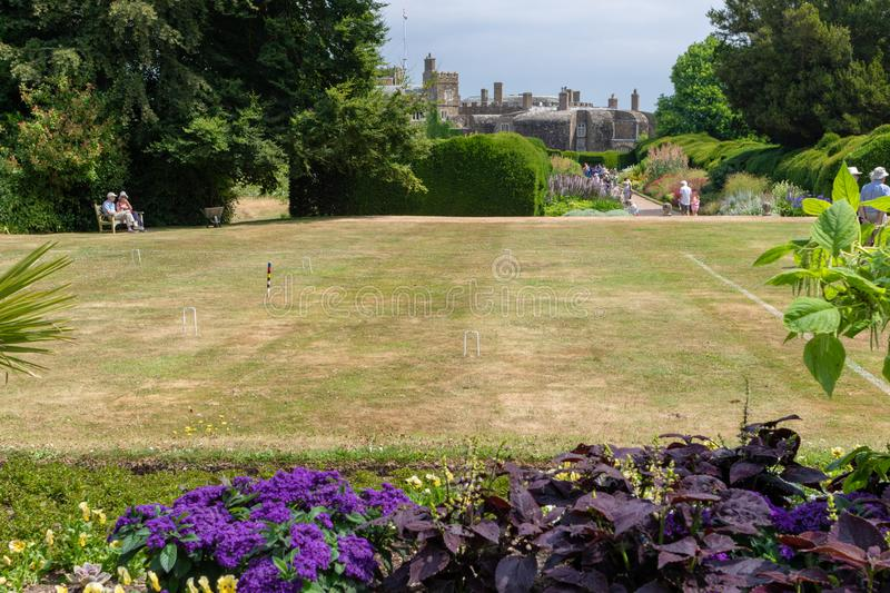 Game of croquet ready at lawn of a formal garden in Walmer castle. Walmer Castle & Gardens, UK - July 19,2018: Game of croquet ready at lawn of a formal garden stock photo