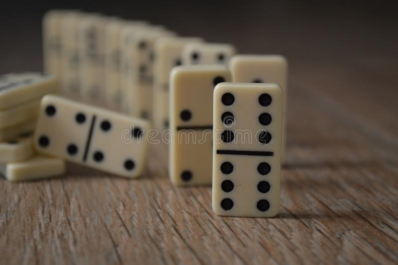 Game of domino on table fortun win fun play with number group objects royalty free stock images