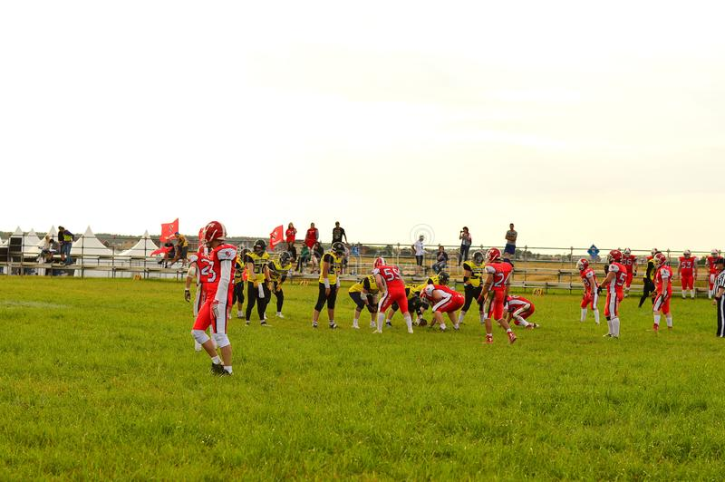 American football. Game moment in the match between amateur teams on the green platform of the festival. KOSINO, RUSSIA JULY 17, 2015 : American football. Game stock photo