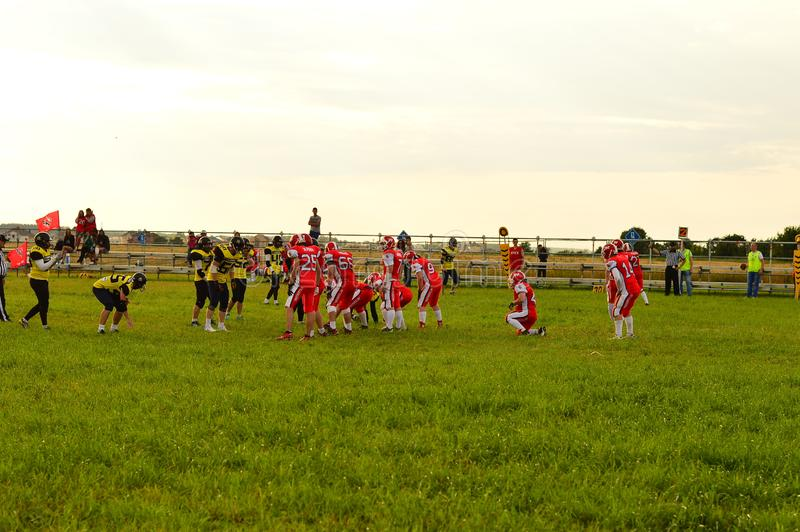 American football.Game moment in the match between amateur teams on the green platform of the festival. KOSINO, RUSSIA JULY 17, 2015 : American football. Game royalty free stock photography