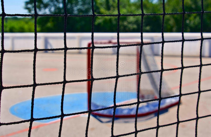 Game Over. A hockey net, on an abandoned roller hockey rink stock image