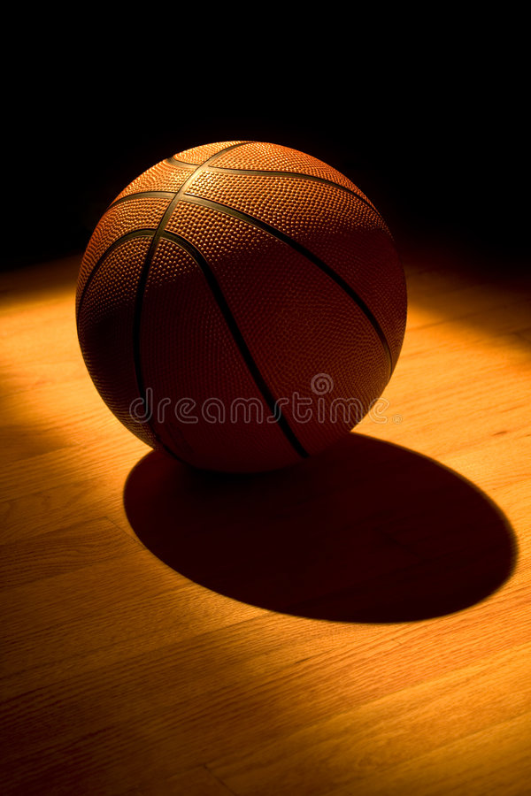 Game over. Basketball left on the court after a game stock image