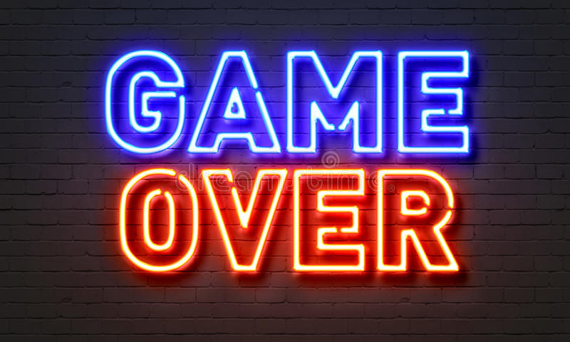 Game over neon sign on brick wall background. royalty free stock photo