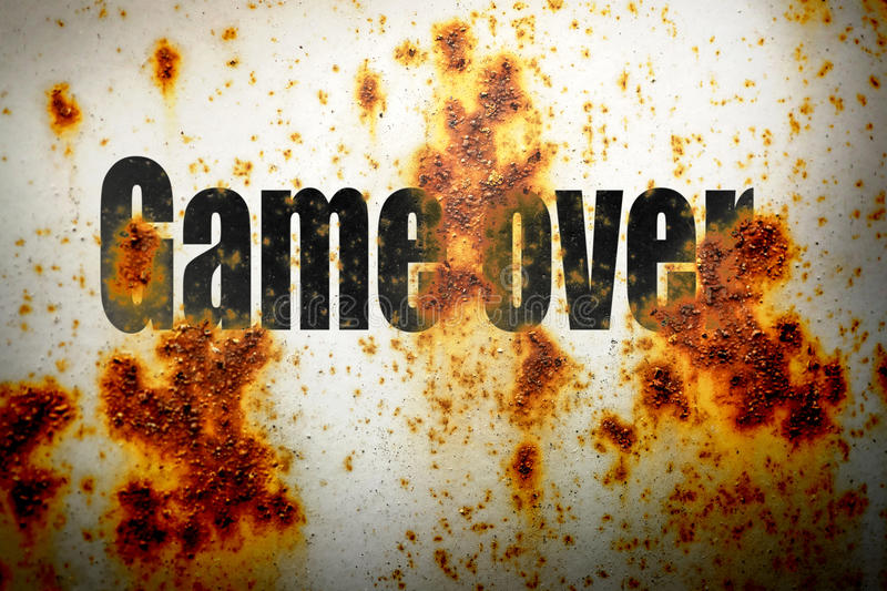 Game over on rusty piece of metal stock images