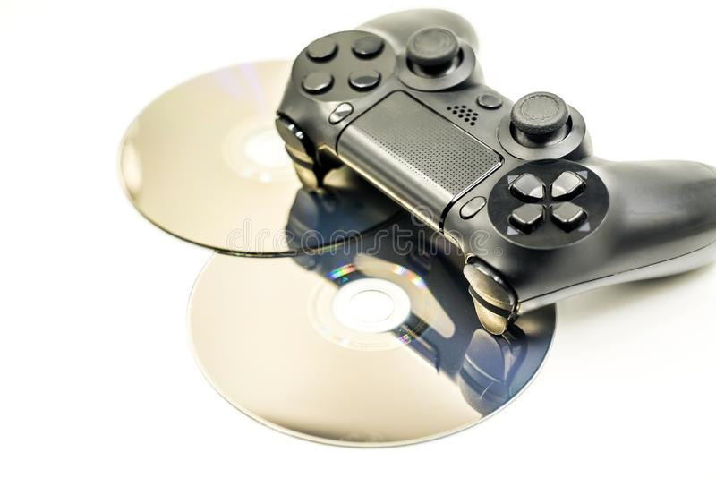 Game Pad and a CD isolated on a white background stock images