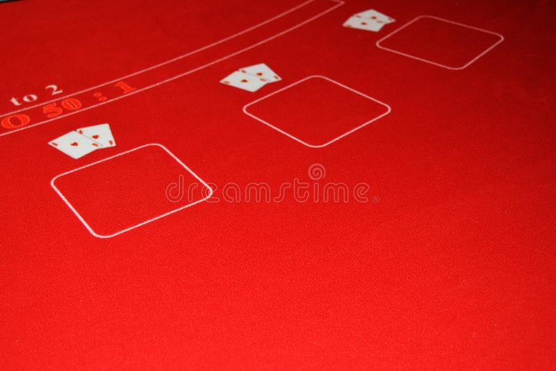 Game table covered with red cloth for casino gambling, two pairs of aces, the concept of luck, luxury, wealth, leisure, selective royalty free stock photos