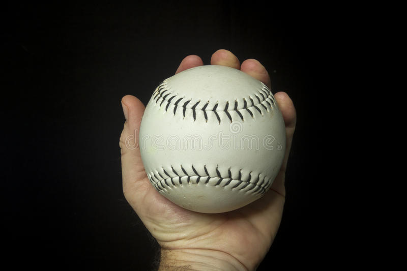 Game Used White Softball In Hand.  royalty free stock images