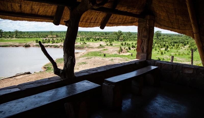 Game viewing hide in Hwange National Park Zimbabwe. Hwange, Zimbabwe, 9 January - 2019: Game viewing hut in National Park royalty free stock photography