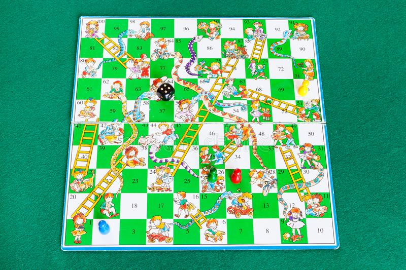 Gameboard of Snakes and Ladders board game royalty free stock photography