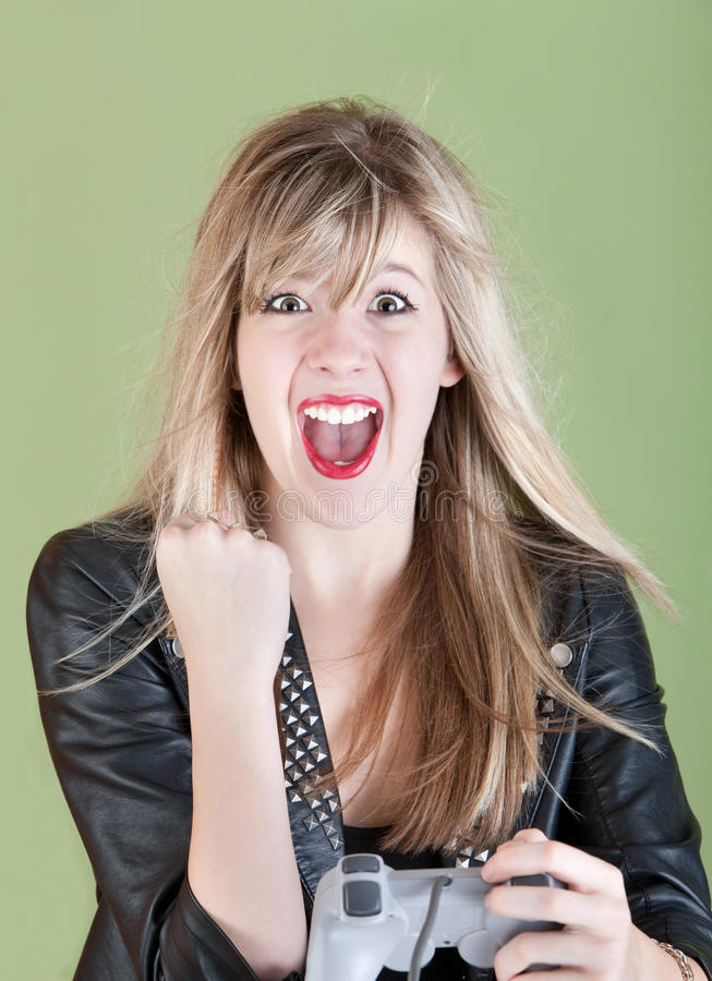 Gamer femminile felice immagine stock