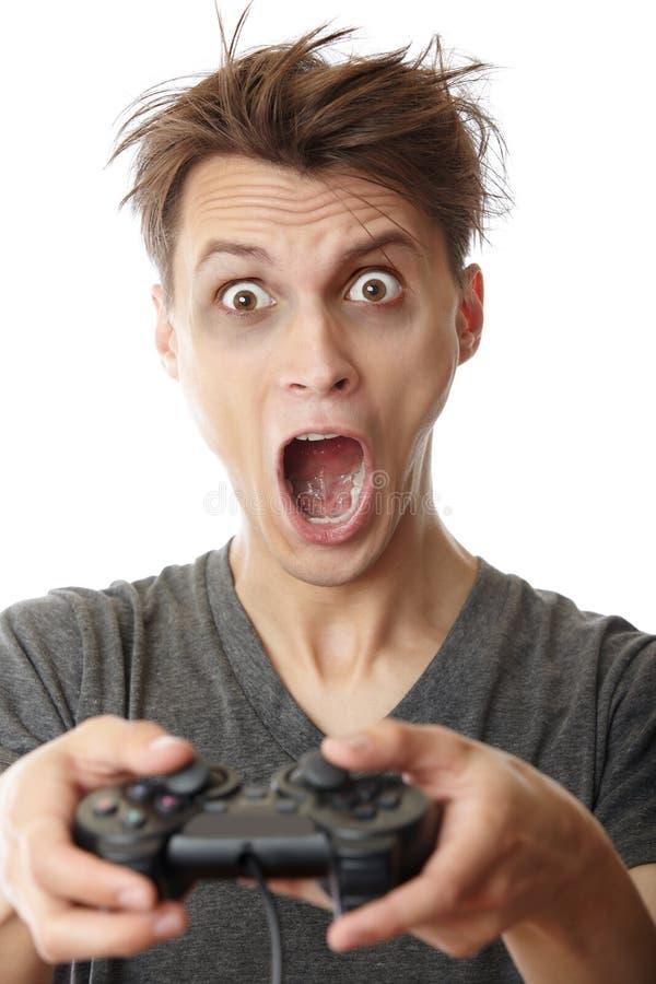 Gamer fou d'ordinateur photos libres de droits