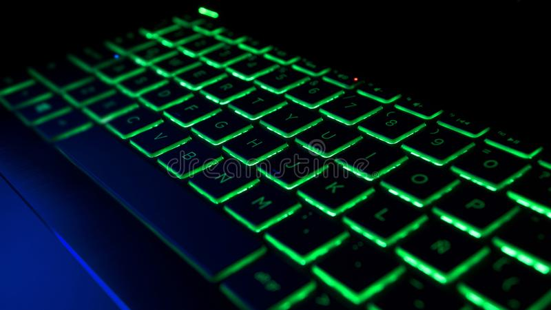 Gamer Keyboard with green and blue backlight. Modern gaming computer stock images