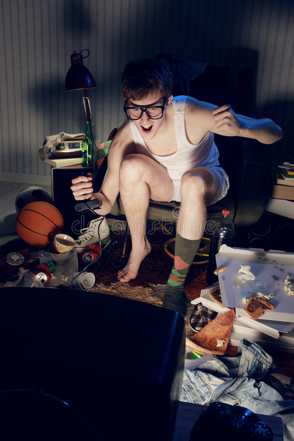 Gamer nerd playing video games on television royalty free stock photos