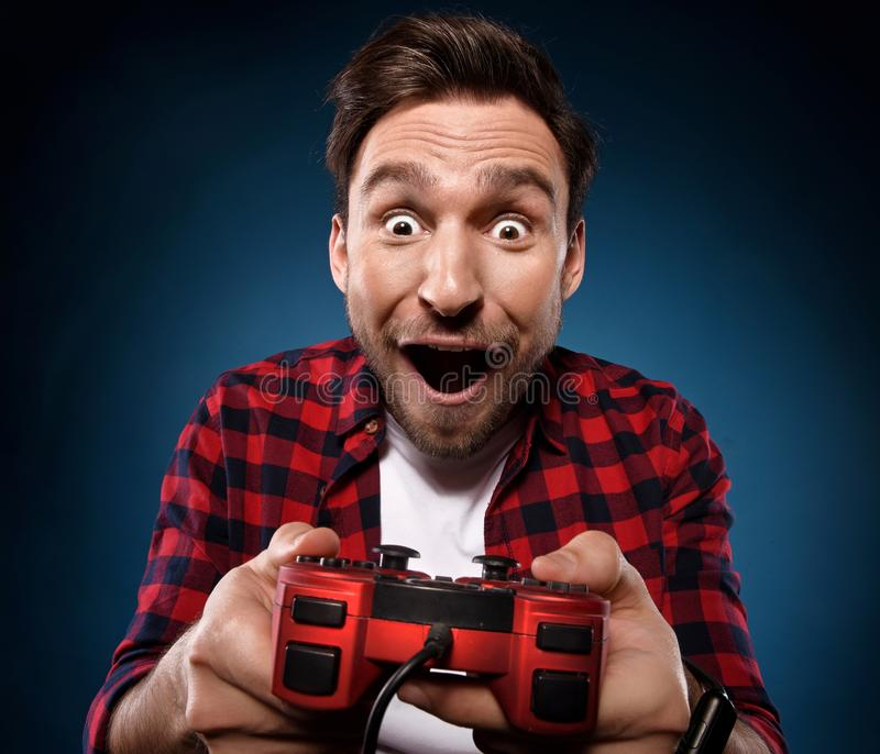 gamer is playing a video game with his red joystick royalty free stock image