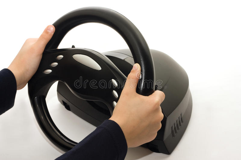 Gamer with a steering wheel stock images