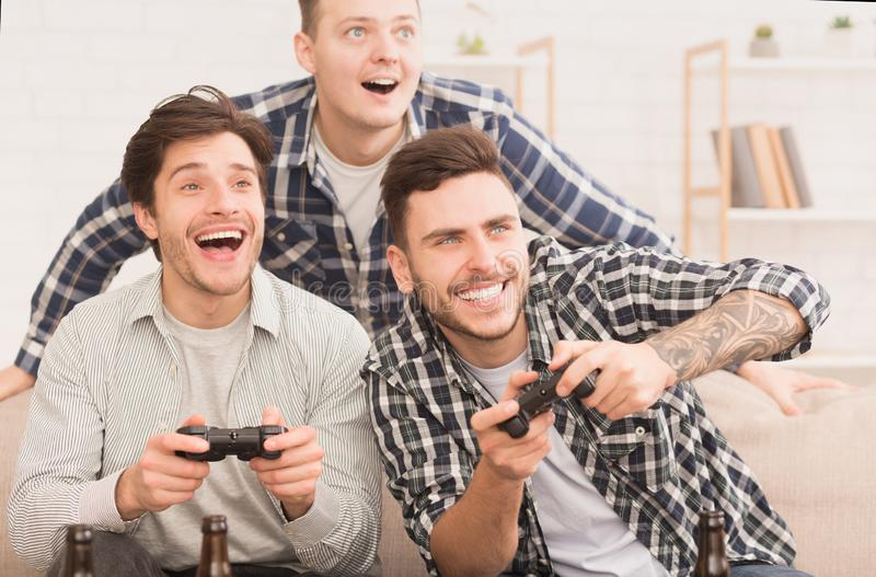Gamers. Happy Friends Playing Video Games At Home royalty free stock photos