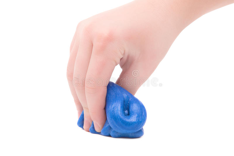 Games mucus in child`s hands. On a white background stock images