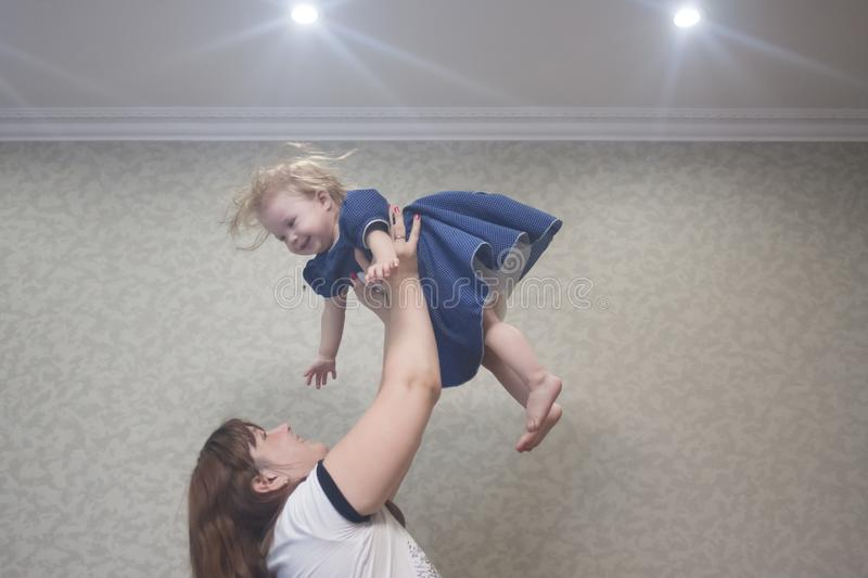 games with a small baby. mom stock photos