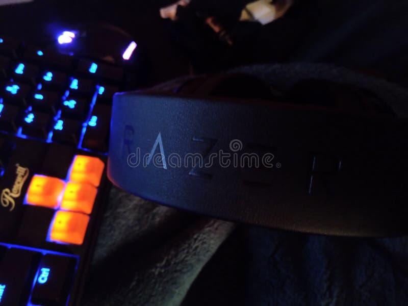 Gaming Accessories 003 - Razer/Rosewill. Gaming headset  razer kraken  gamer black  nerd tech accessory peripheral   surround sound audio  synapse stock image