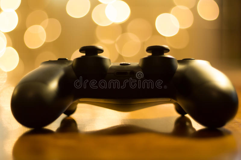 Gaming at Christmas. A gaming controller on a table at chrismas time stock images