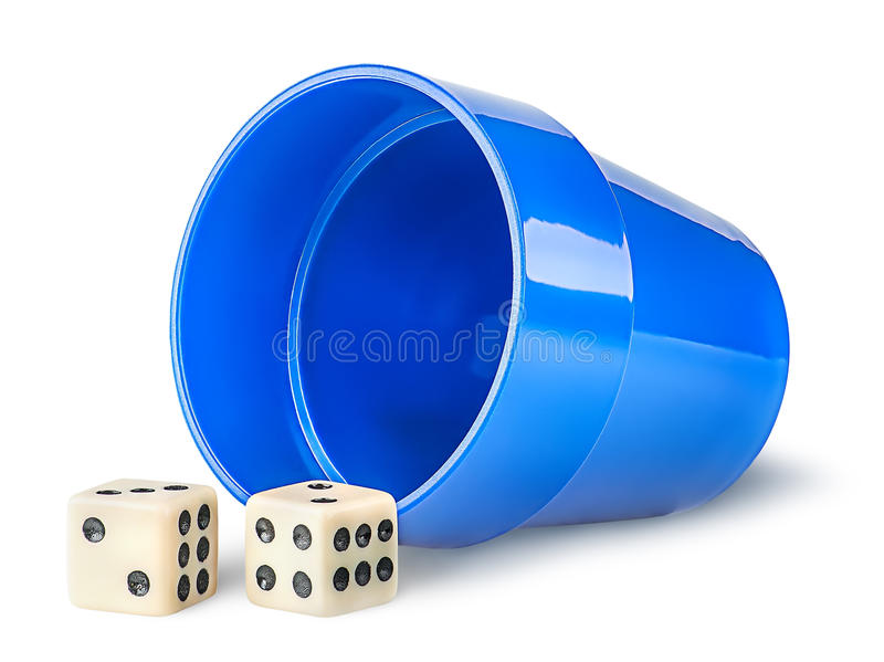 Gaming dice and cup. Isolated on white background royalty free stock photos