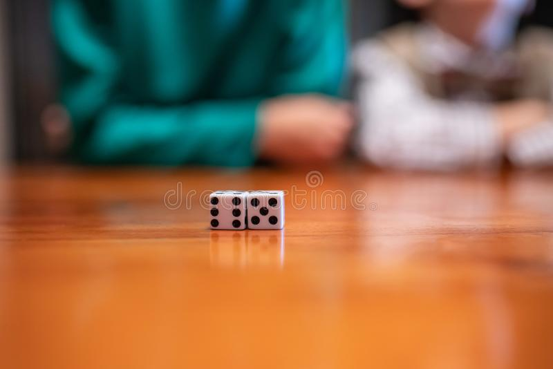 Gaming dice on the table with kids stock images