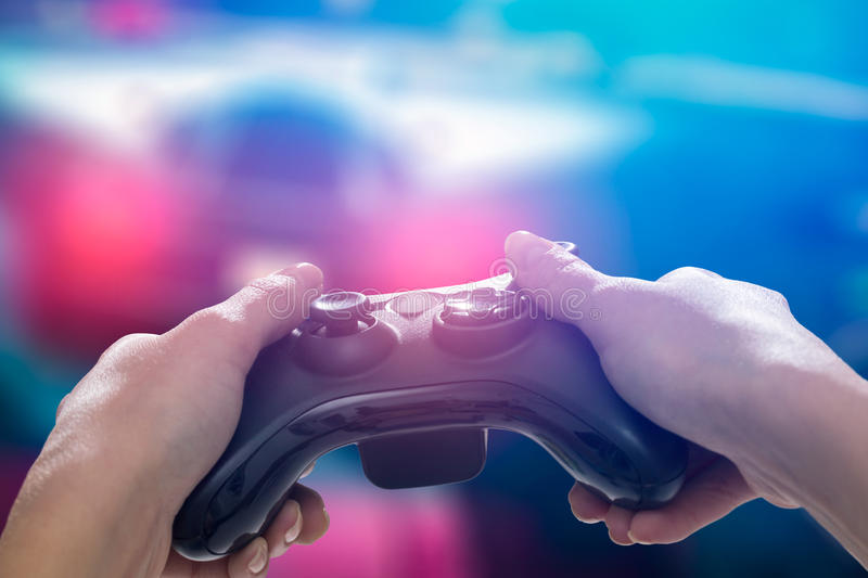 Gaming game play video on tv or monitor. Gamer concept. Gaming game play tv fun gamer gamepad guy controller video console playing player holding hobby playful royalty free stock image