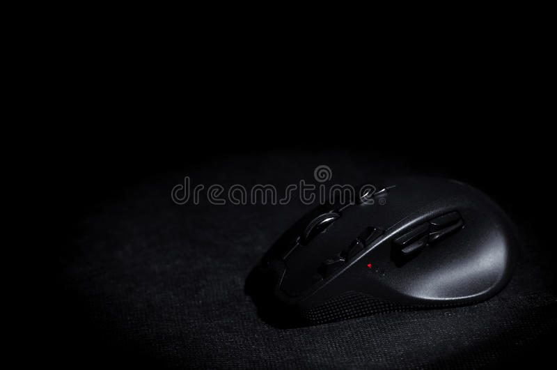 Gaming mouse. Professional optical mouse for gaming. Copyspace of black background stock photography