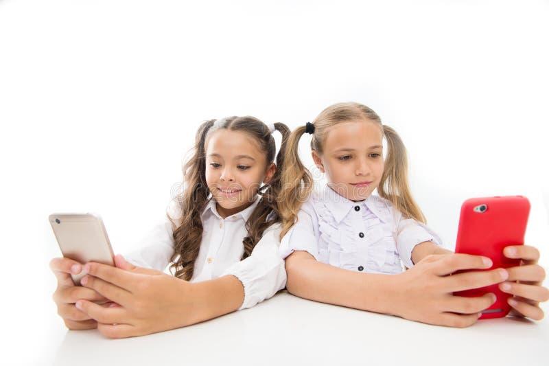 Gaming online. Blogger school. Educational application. Schoolgirls smartphones surfing internet social networks. Send. Message. Online communication. Create stock images