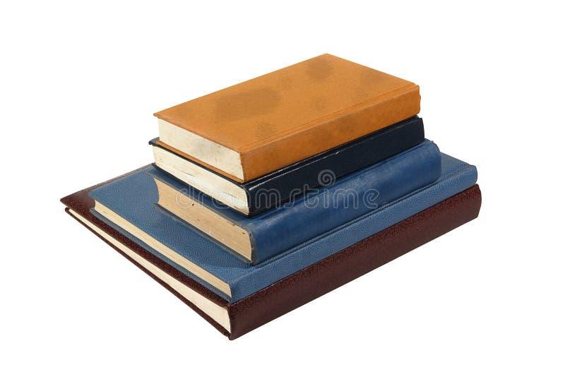 Gamla böcker som isoleras på vit royaltyfria bilder