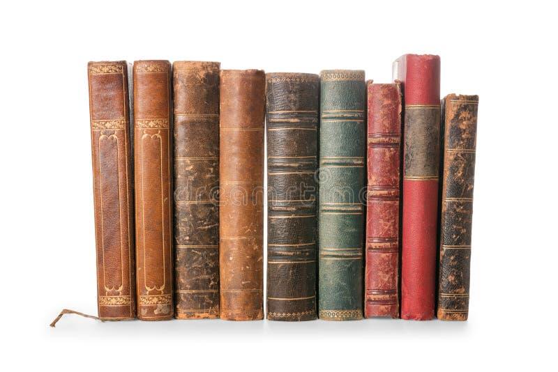 Gamla böcker som isoleras på vitt med urklippbanan arkivfoto