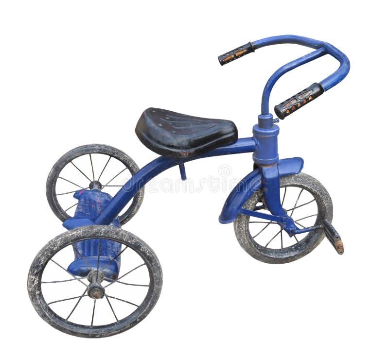Gamla blåa isolerade barns trehjuling. royaltyfri fotografi
