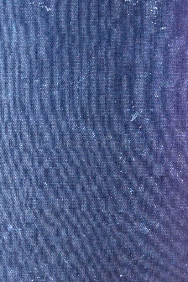 Gamla färgade bokomslagtexturblått arkivbild