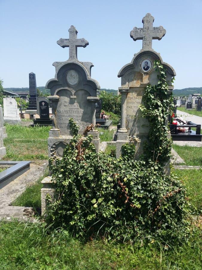 Gamla gravstenar som göras av stenen arkivfoton