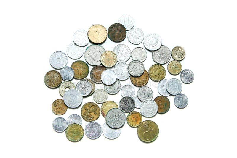 Gamla ogiltiga mynt från olika europeiska länder royaltyfri foto