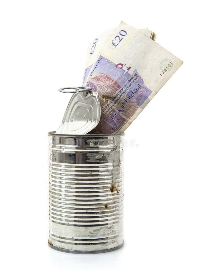Gamla rostiga Tin Can mycket av 20 pund anmärkningar arkivbilder