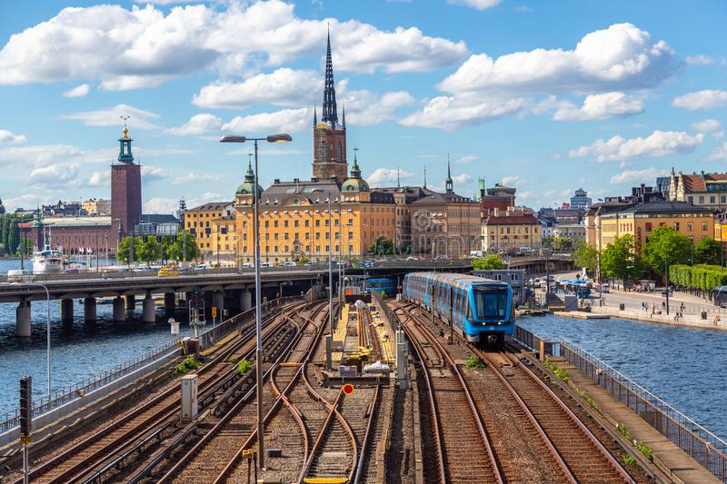 Gamla Stan old town at night in Stockholm, Sweden. Stockholm, Sweden - June 2016: Railway tracks and trains near Stockholm`s main train station in Norrmalm area stock images
