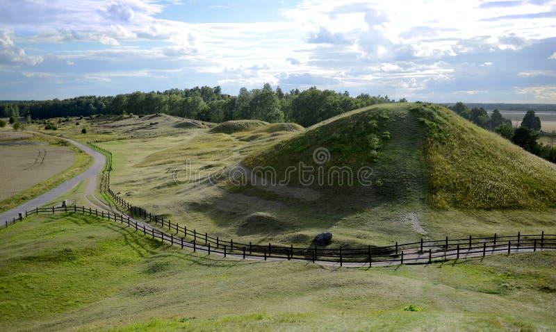 Gamla Uppsala, Sweeden. The burial mounds of Vikings in Gamla Uppsala in Sweeden stock image