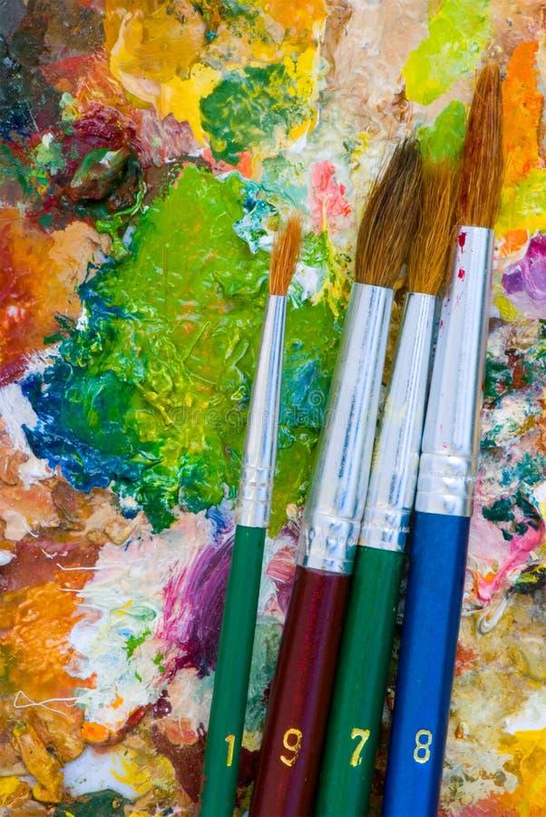 Gamma di colori e pennelli fotografie stock libere da diritti