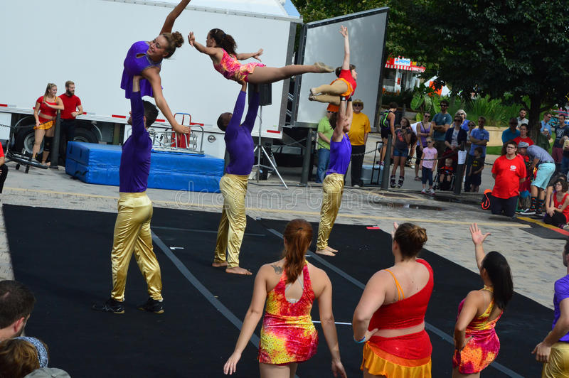 Gamma Phi Circus acrobats. Bloomington City, USA - August 27, 2016 - Gamma Phi Circus acrobats at Sweetcorn and Blues Festival - This photo was taken during royalty free stock image