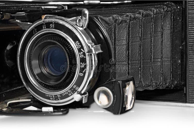 Gammal, antik, svart fick- kamera, närbild av linsen arkivbild