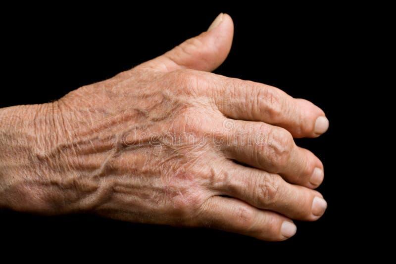 gammal artrithand royaltyfri bild