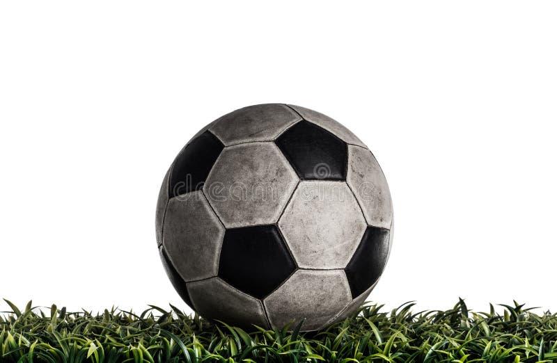Gammal fotbollboll i studion royaltyfri fotografi