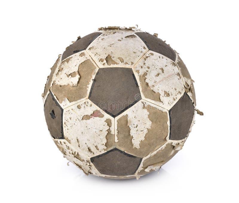 Gammal fotbollboll på vit bakgrund arkivbilder